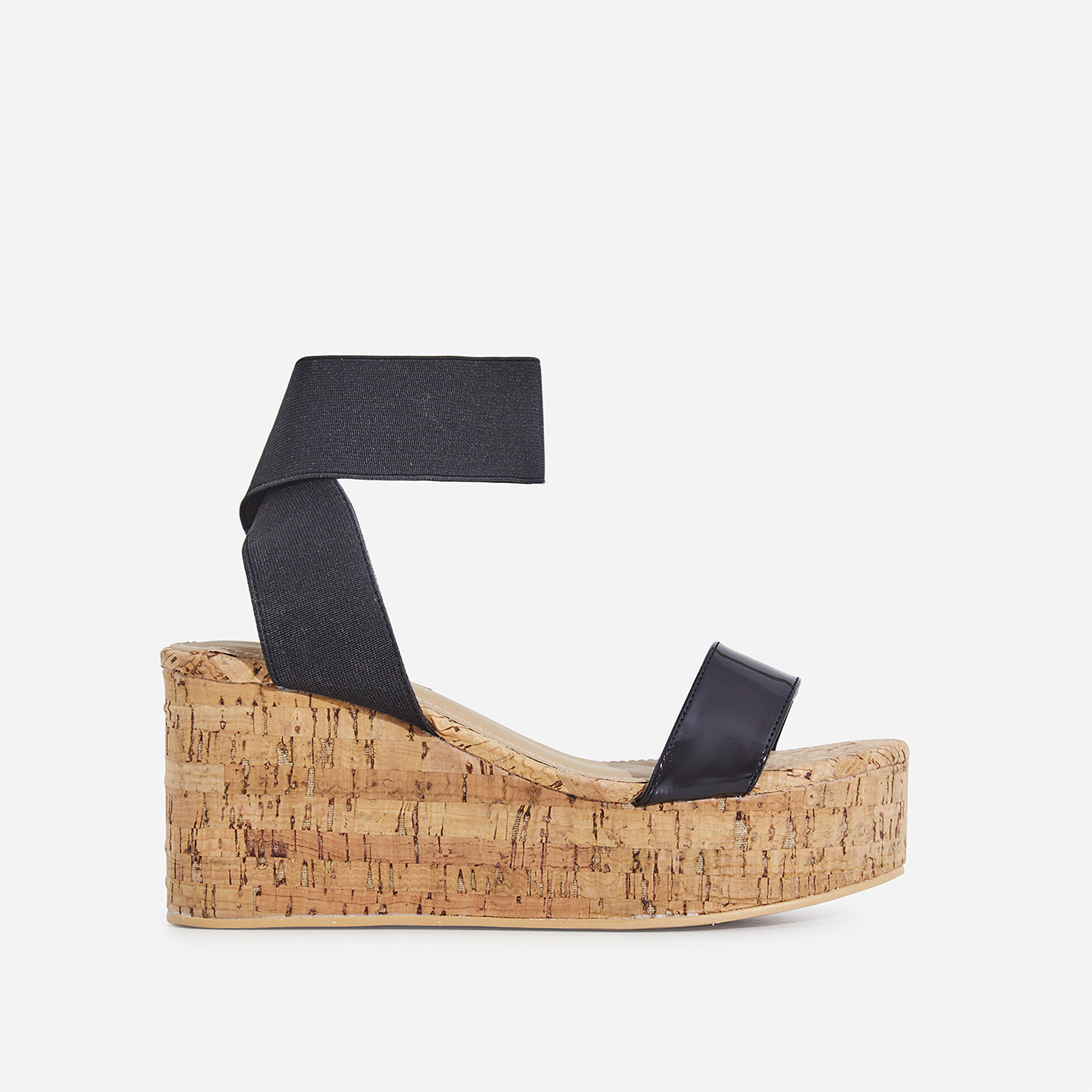 25b492462d65 Andie Elasticated Wedge Sandal In Black Patent