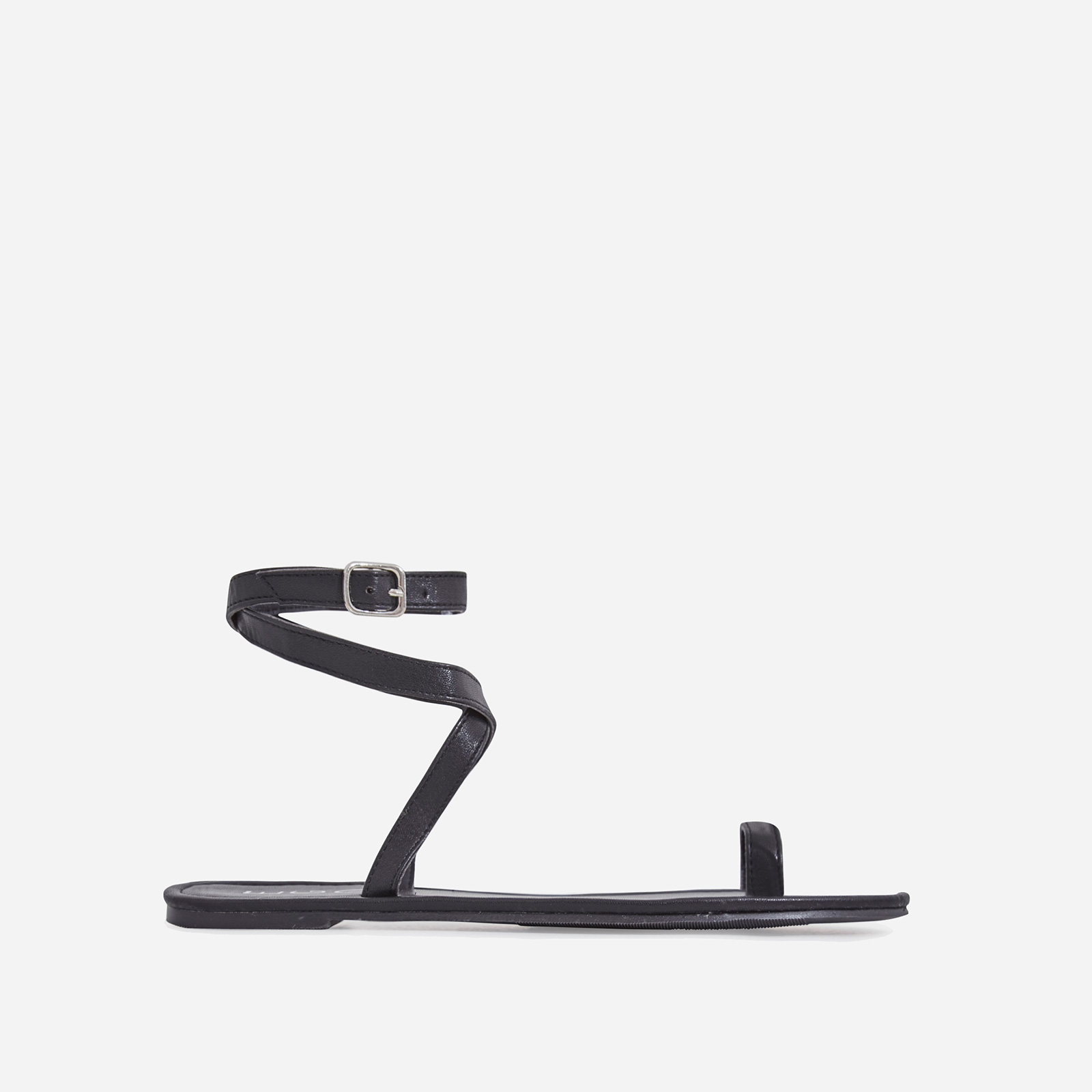 Cara Lace Up Toe Strap Flat Sandal In Black Faux Leather