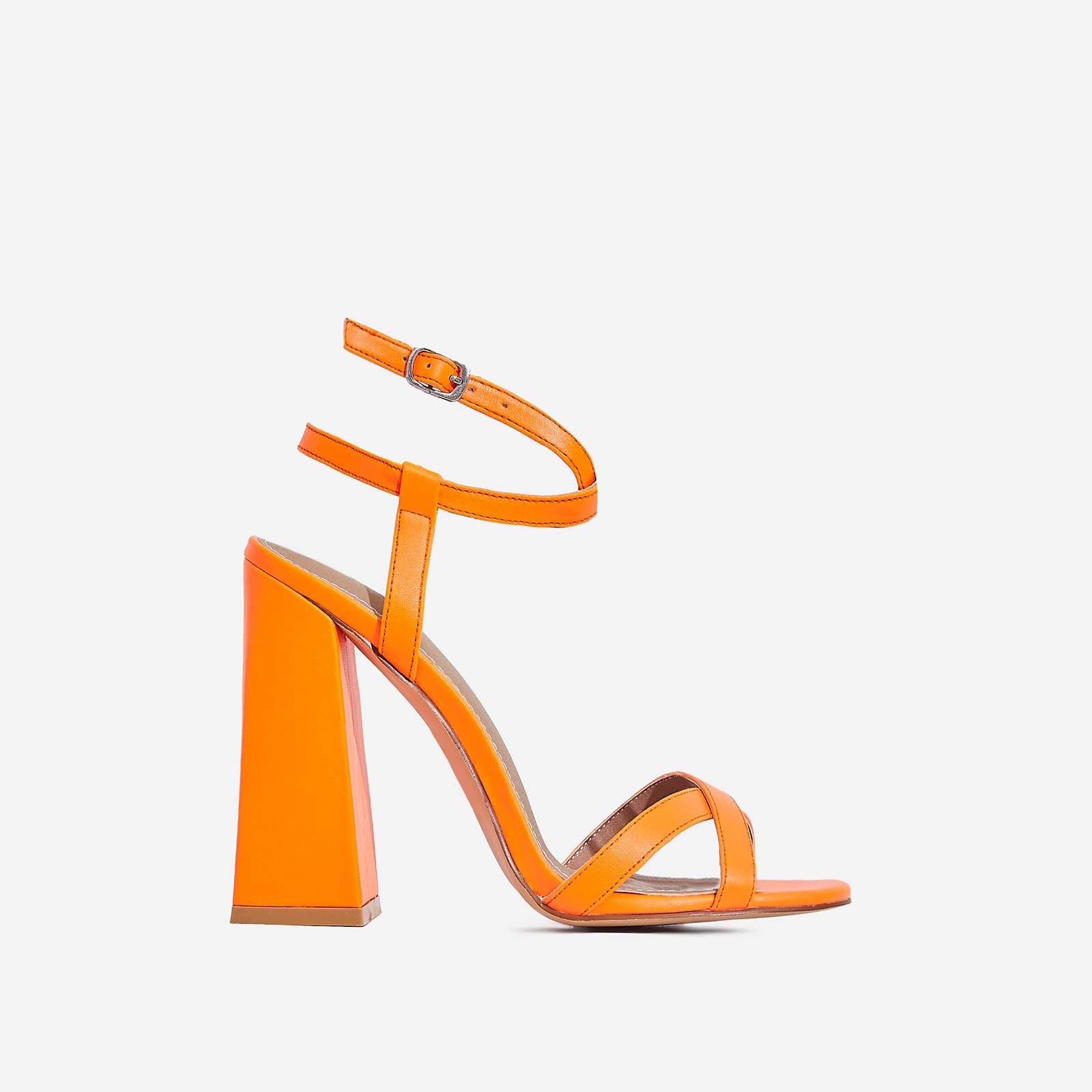6b7fc1a6923 Iris Flared Block Heel In Neon Orange Faux Leather