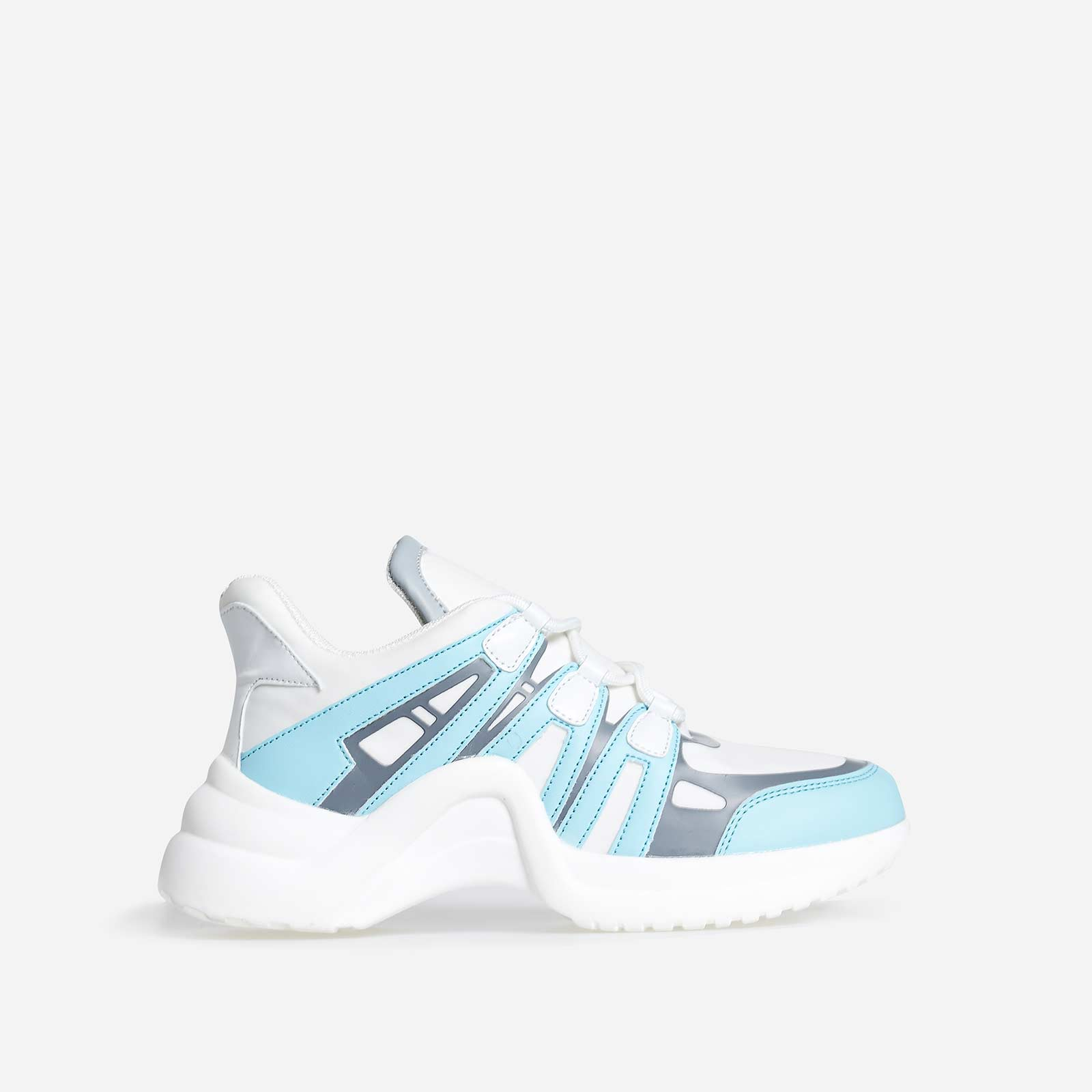 Marisa Wave Sole Trainer In White And Blue Faux Leather