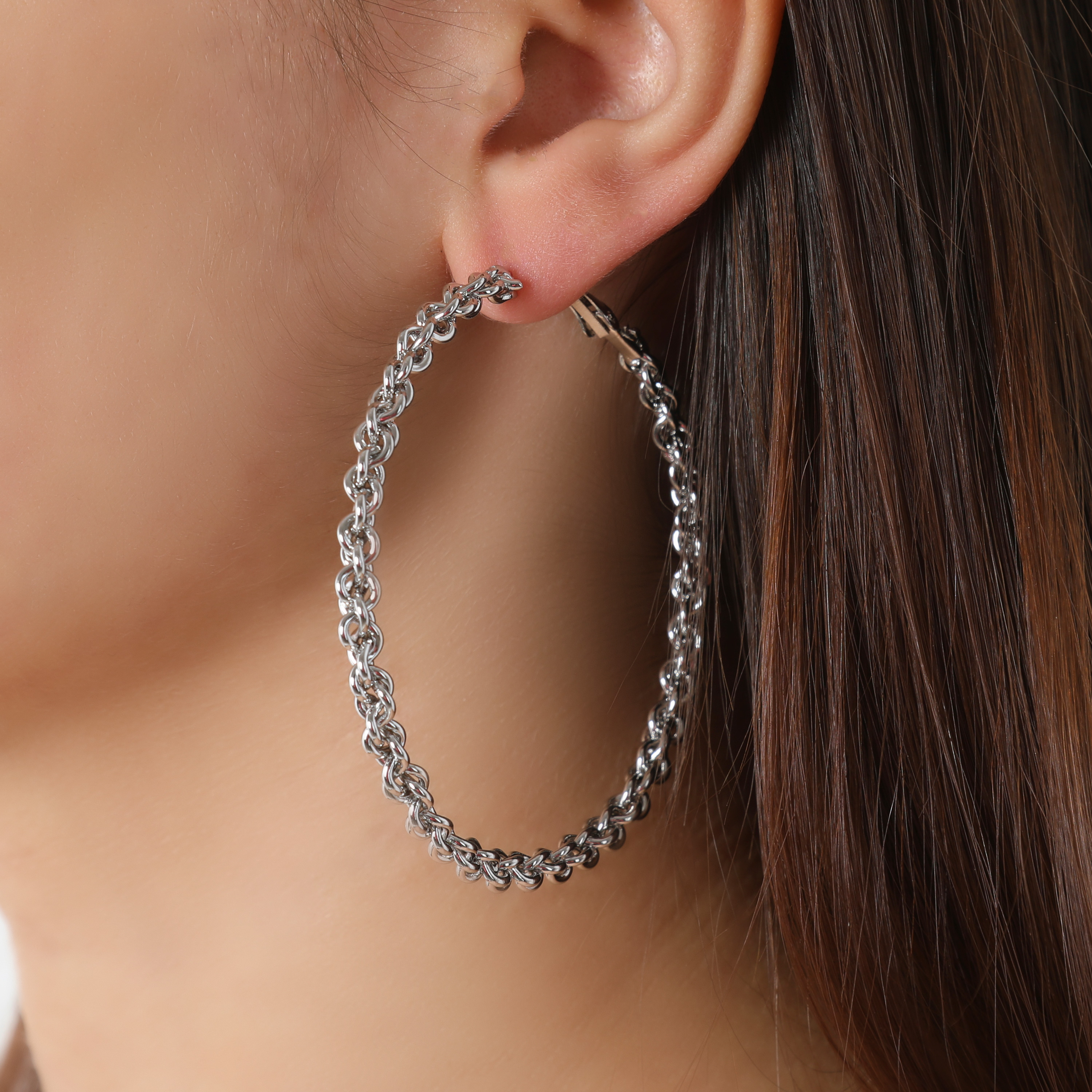 Thin Twisted Hoop Earrings In Silver