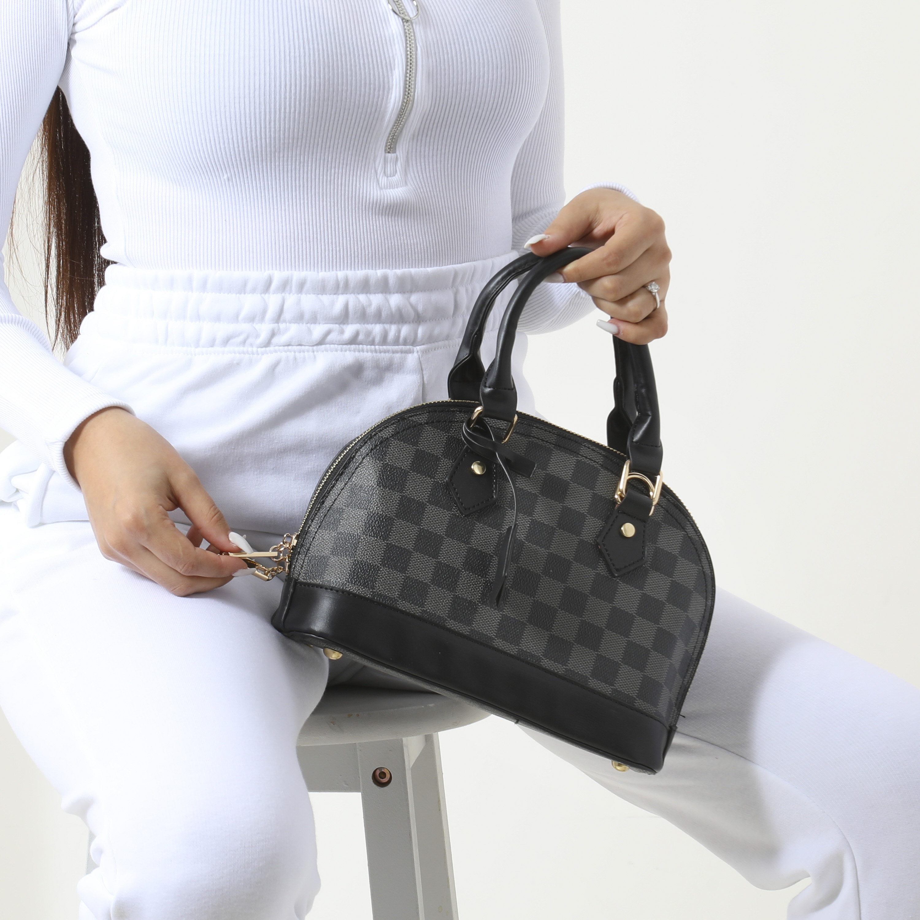 Checked Oval Handbag In Black Faux Leather
