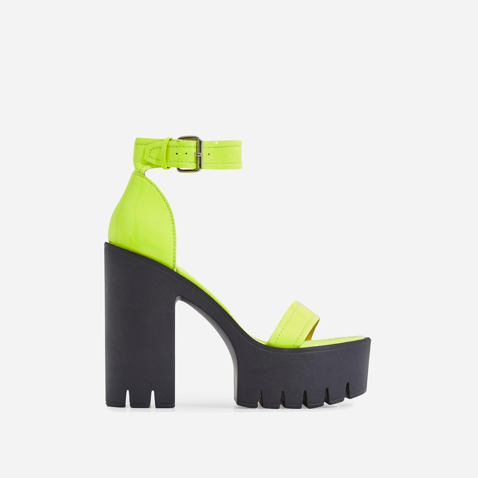 Stormi Platform Cleated Sole Block Heel In Neon Yellow Patent