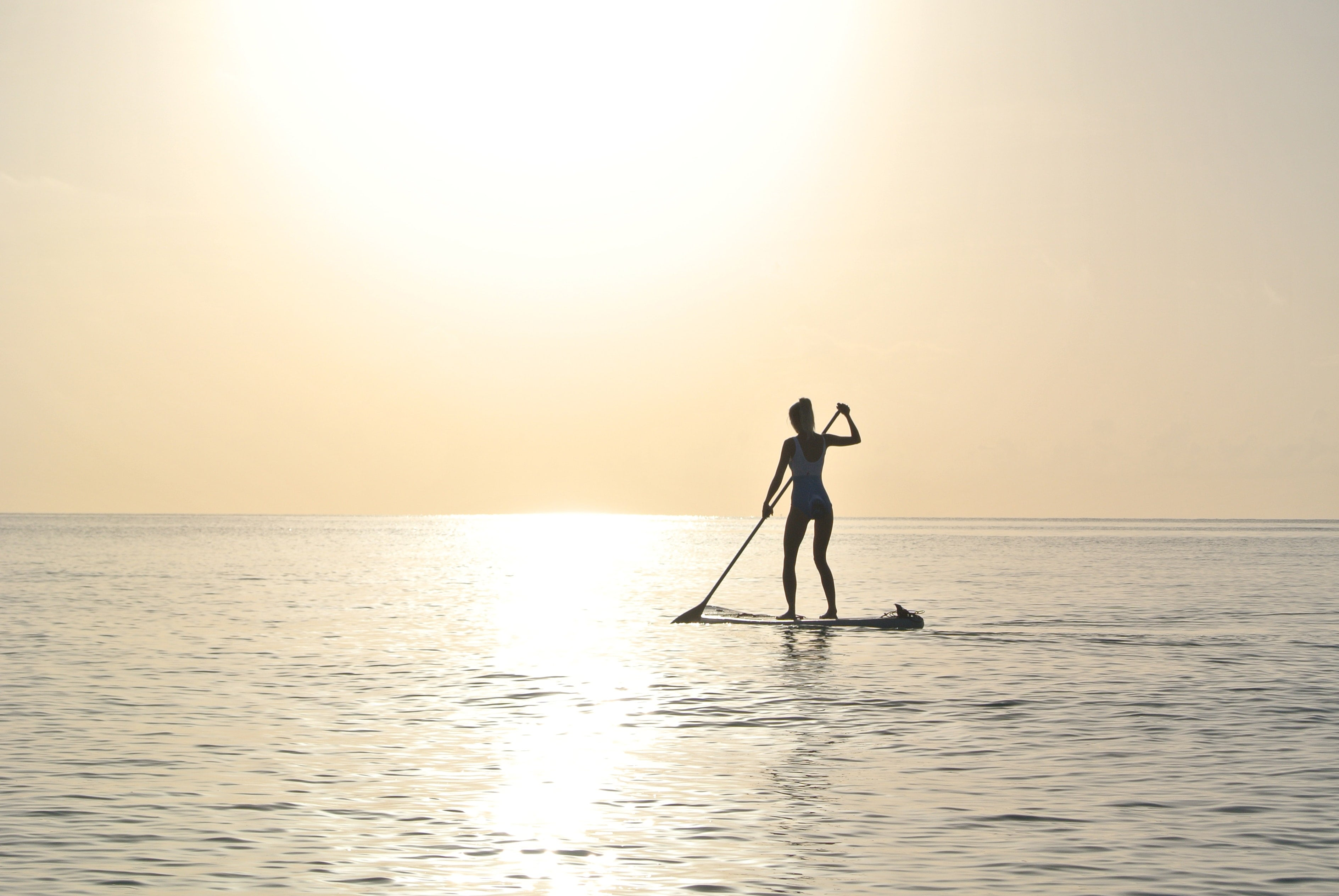 An image of a girl stood on a paddleboard in Australia, a country famous for travelling and gap years